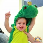 Baby in frog costume
